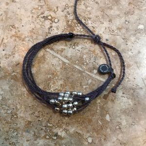 Pura vida bracelet with silver beads brown band